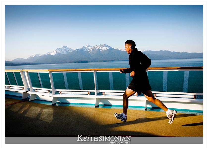 A guest of the Radiance of the Seas takes in the amazing sites while using the 12 deck jogging tracking to stay in shape