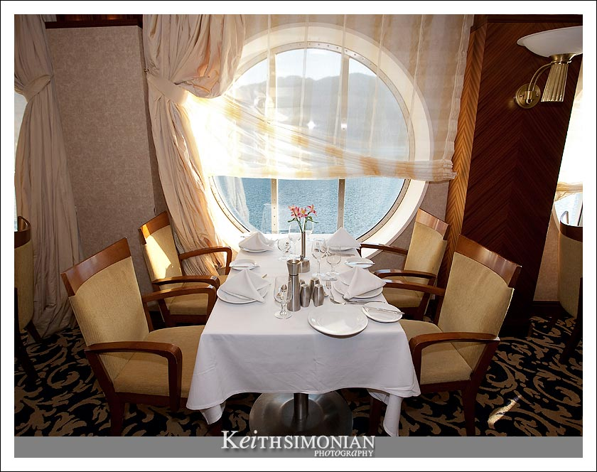 Seating for four with a view of the Ocean aboard the Radiance of the Seas Royal Caribbean International