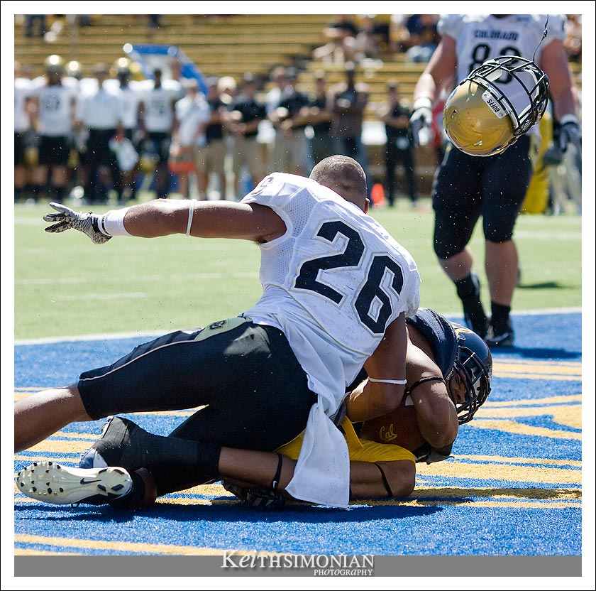 Ray Polk of Colorado has his helmet send flying on this touchdown play - Cal vs Colorado college football - September 11, 2010 - Memorial Stadium - Berkeley, CA