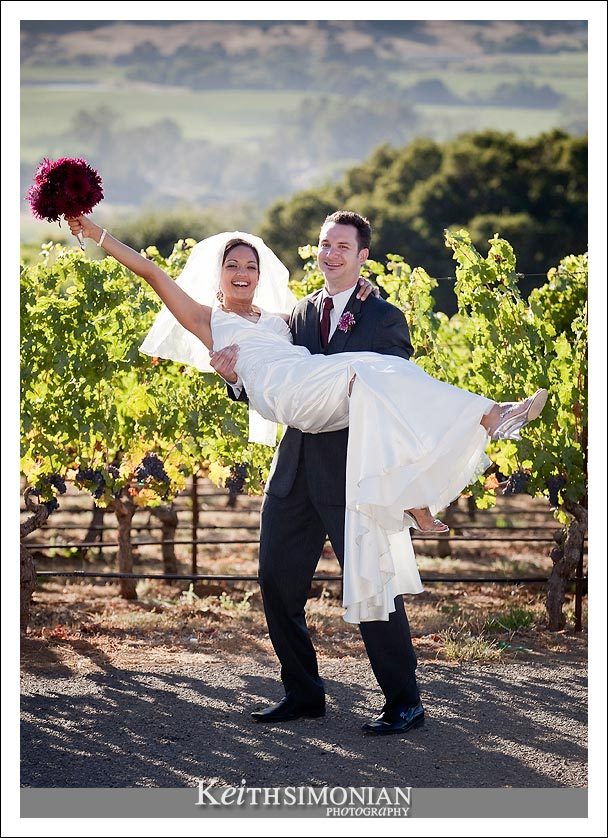 Bride and Groom in front of vineyards with view of Napa Valley