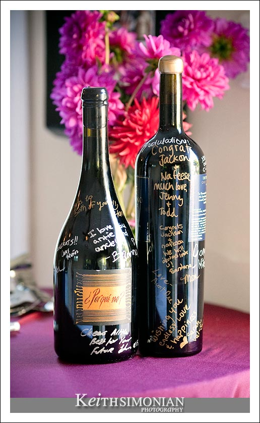 Guest to the wedding signed wine bottles