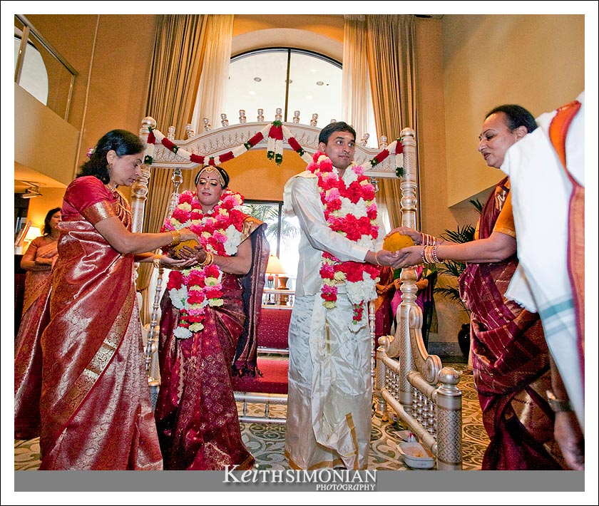 Family members help during the swing ceremony of Indian wedding