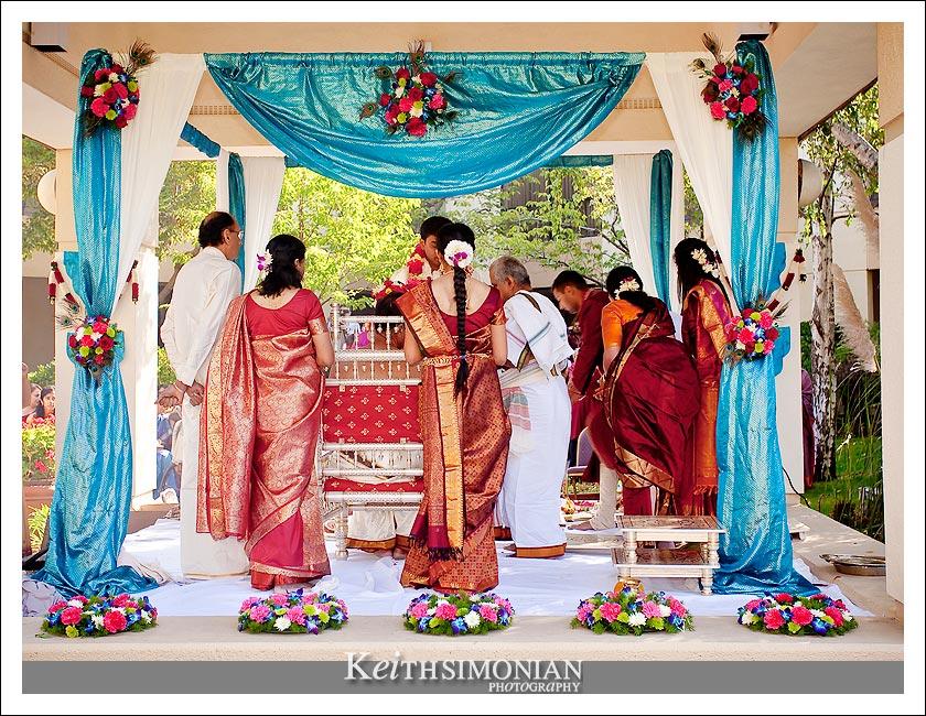 Bride and groom under 4 pillar mandap