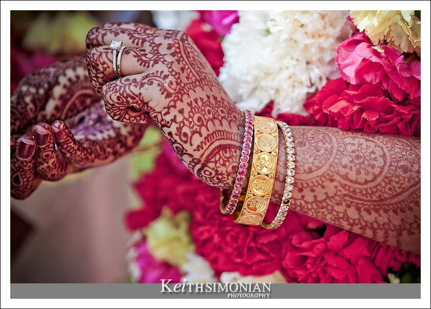 Henna skin decorations and gold jewelery adorn the bride