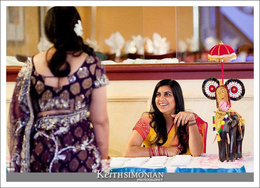 Bride chats with guest at the reception