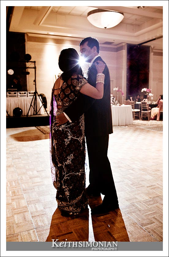 Photo of bride and groom during their first dance as husband and wife.