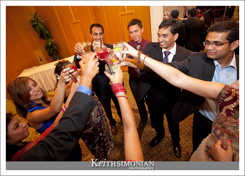 A toast to the bride and groom with friends