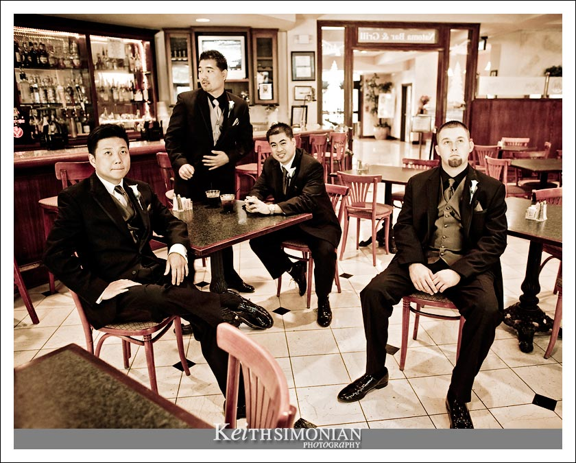 Groom and groomsmen waiting in the bar - black and white photo