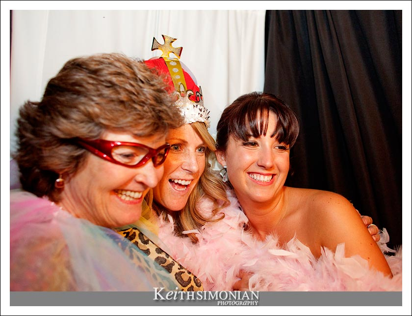 Bride and guests ham it up in the photo booth