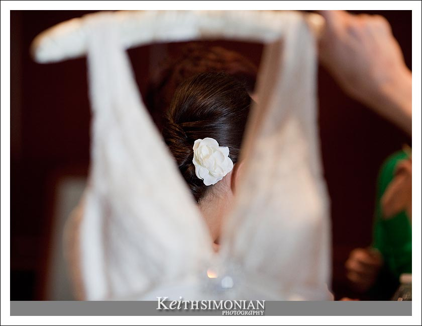 Bride getting ready with flower in her hair