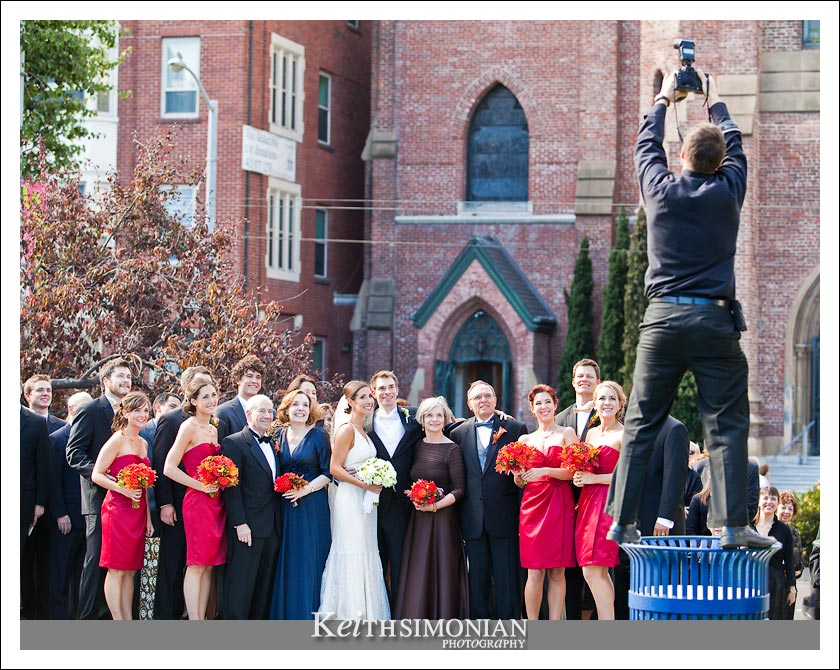 Photo of wedding photographer taking a group photo