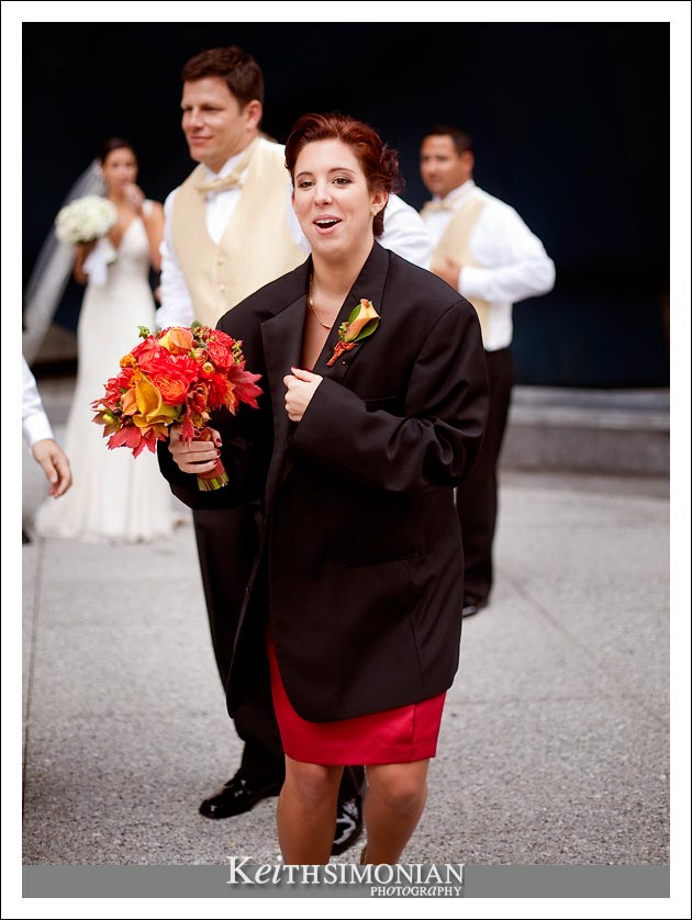 With a chill in the air, one of the bridesmaids wears a groomsmen's tux jacket