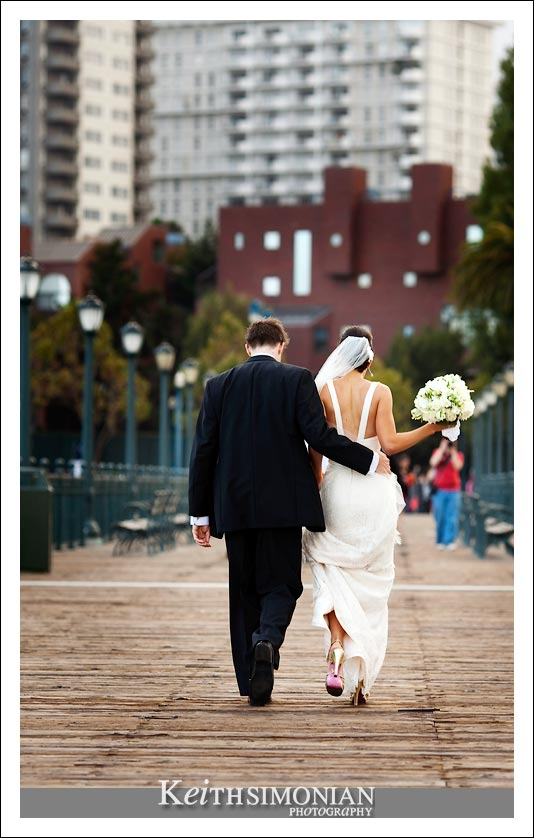 Bride and groom in photo with the San Francisco skyline in the background