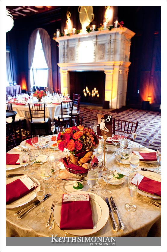 Photo of table setting and fireplace in the Julia Morgan ballroom in San Francisco, California