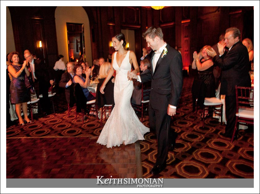 The couple enter the ballroom and are announced to their guests