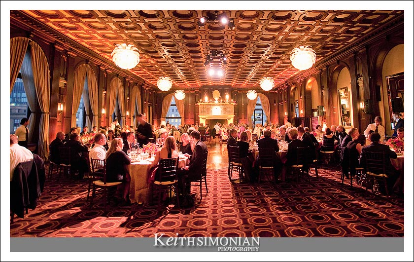 Wide angle photo of the wedding reception in the Julia Morgan Ballroom in the Merchants Exchange building in San Francisco California