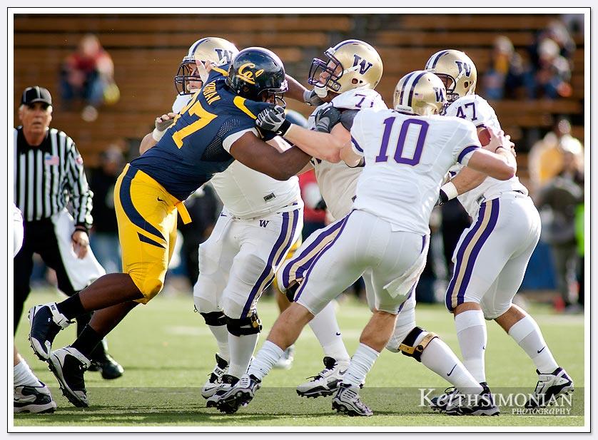 Cal's defensive lineman #97 Cameron Jordan tries to chase down Washington quarterback Jake Locker