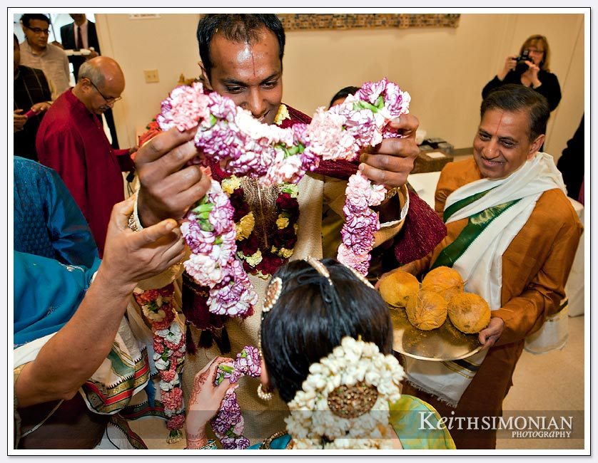 During the exhange of garlands ( Malai Matral ) the bridegroom places the colorful garland on the Bride at the Shiva-Vishnu Temple in Livermore, California