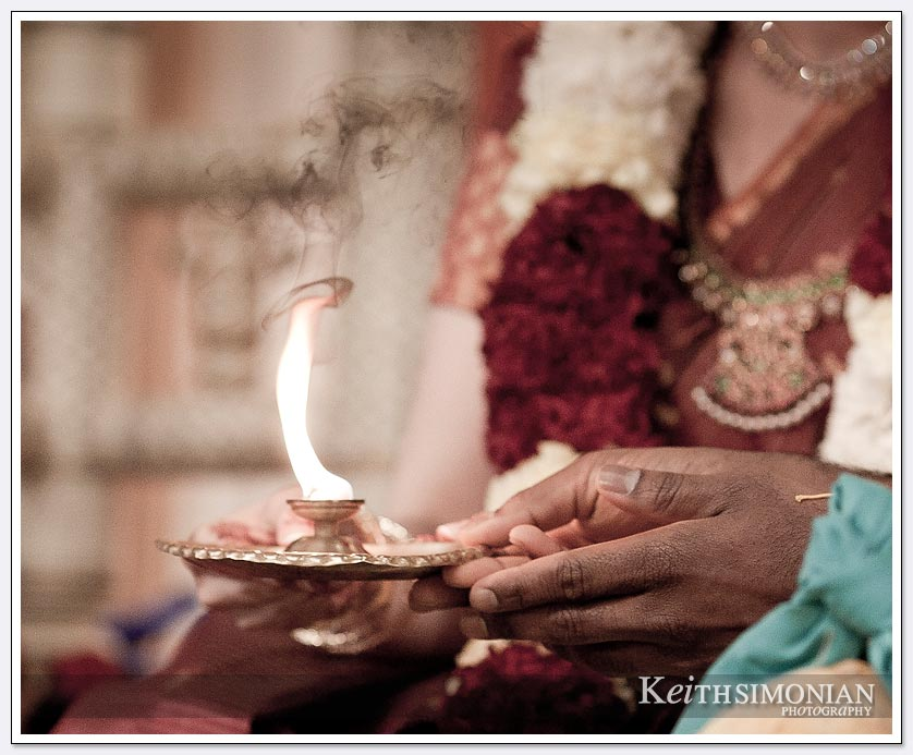 During the South Indian Hindu wedding ceremony the bride and groom hold the flame at the Shiva-Vishnu Temple in Livermore, California