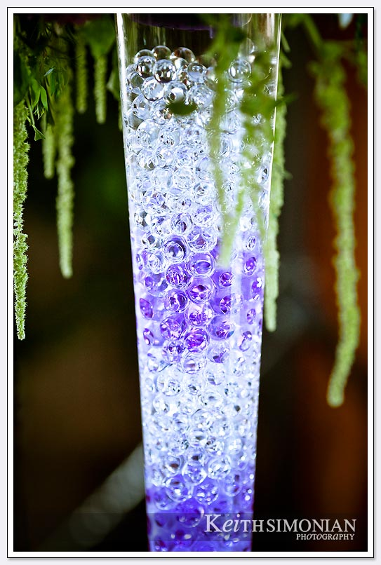 As a decoration a vase is filled with clear and purple marbles for all the reception guests to see at the Castlewood Country Club in Pleasanton, California