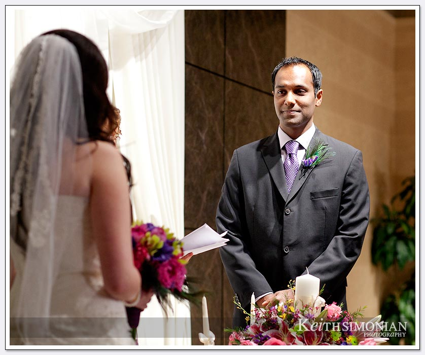 The Groom faces the bride to be during the wedding ceremony at the Newark-Fremont Hilton Hotel