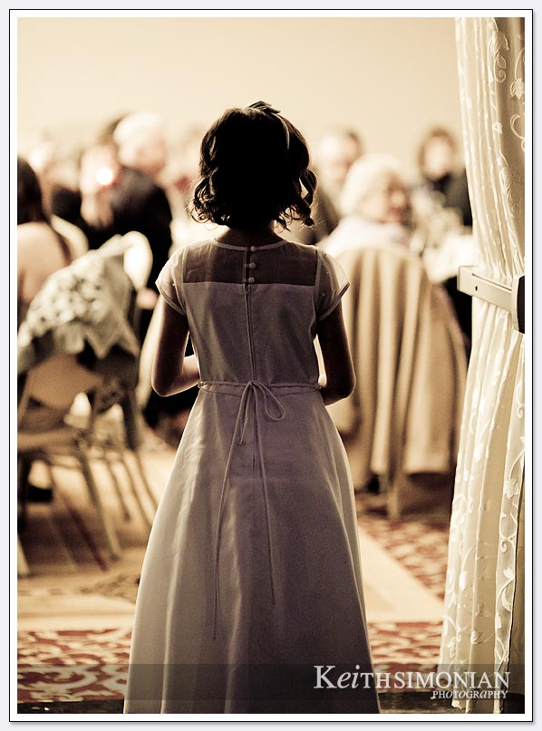 Flower girl about to enter the reception