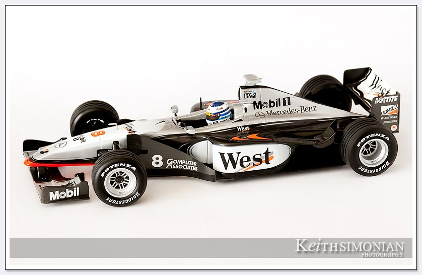 Photo of #8 West McLaren with black and silver coloring driven by Mika Hakkinen
