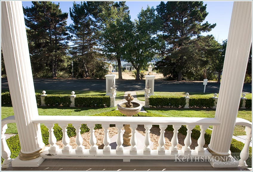 White railing and fountain picture at Jefferson Street Mansion