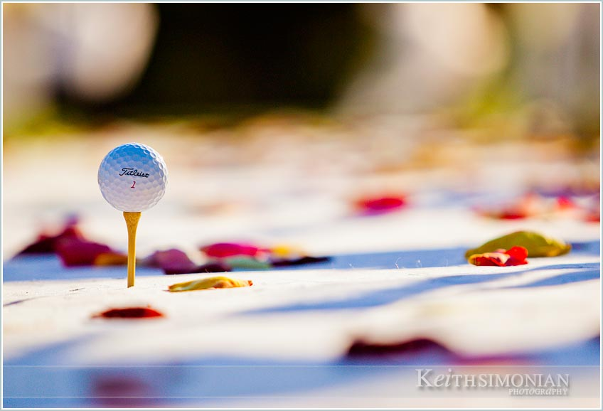 Titlest golf ball teed up with flower pedals on aisle