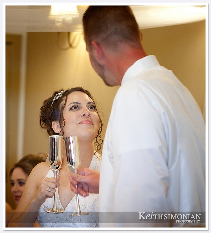bride and groom toasting each other
