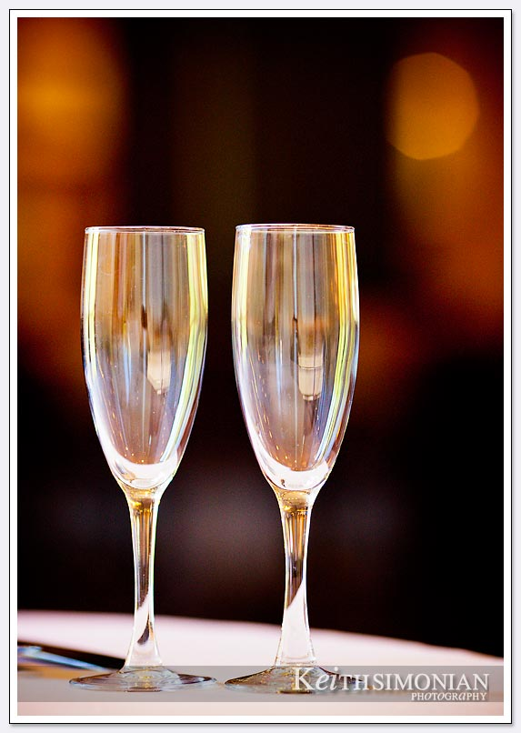 Two Champagne glasses photographed with shallow depth of field