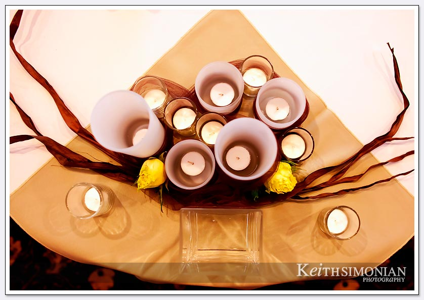 Many different size candles create a table decoration