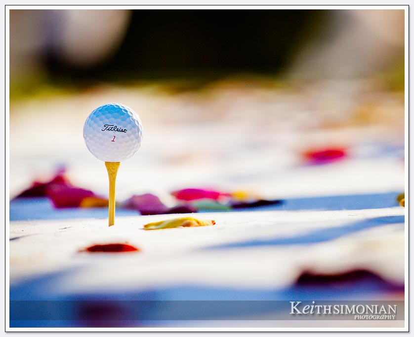 A golf course wedding with flowers and a golf ball