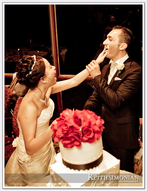 the bride and groom share cake during the cake cutting ceremony