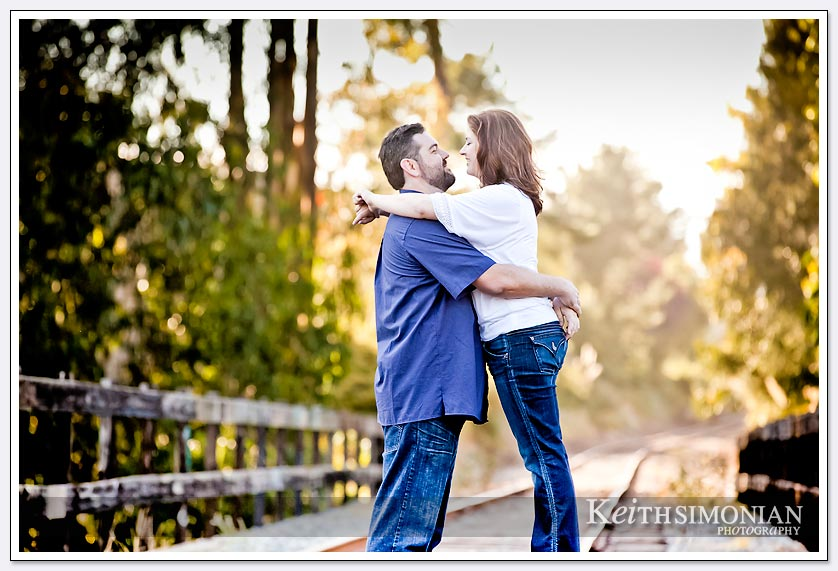 couple on railroad track