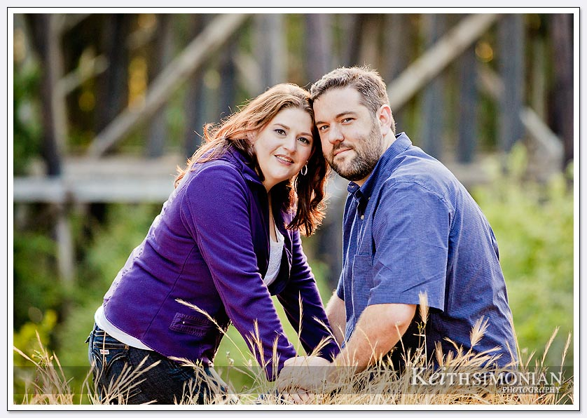 couple with railroad bridge behind them