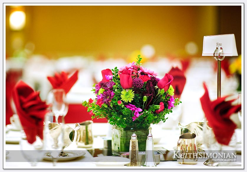 Colorful flowers await guests on the tables at the Crowne plaza reception