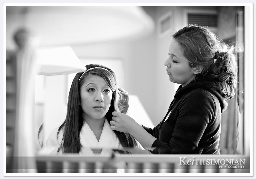 Black and white photo of bride having hair done at Hilton Hotel