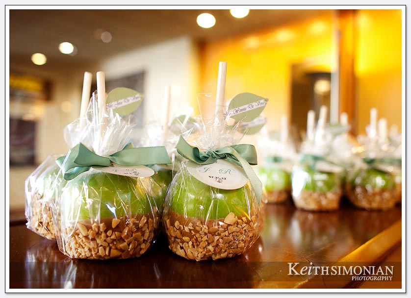 Green candy apples await the guests at the wedding reception