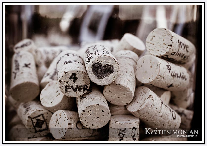 Vintage looking photo of wine bottle corks with drawings and messages from friends and family