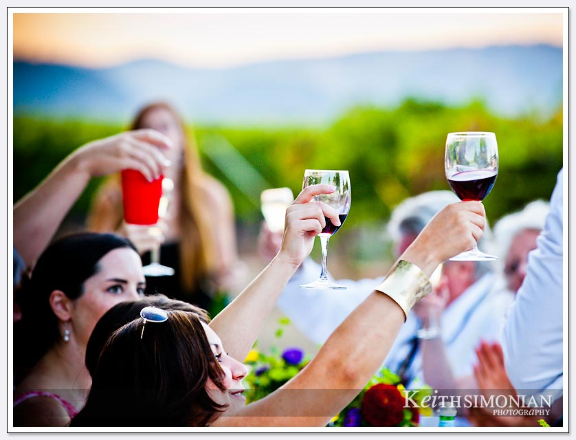 It wouldn't be a Napa Valley wedding without raising wine filled glasses for a toast