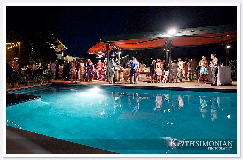 A nice evening breeze and a swimming pool as a backdrop make for a wonderful backyard outdoor wedding reception