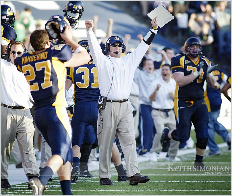 Cal coach Jeff Tedford and players celebrate a California Golden Bear college football touchdown