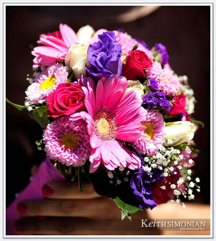 White, pink, blue flowers are part of the bouquet at the Oakland LDS Temple wedding