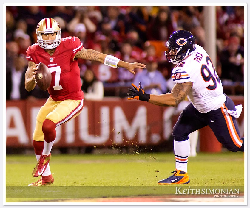 49er quarterback Colin Kaepernick eludes a Chicago Bear defender on Monday Night football - 11/19/2012