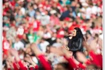 American Idol winner Jordon Sparks is surrounded by a sea of red and gold at 49ers vs Miami halftime show