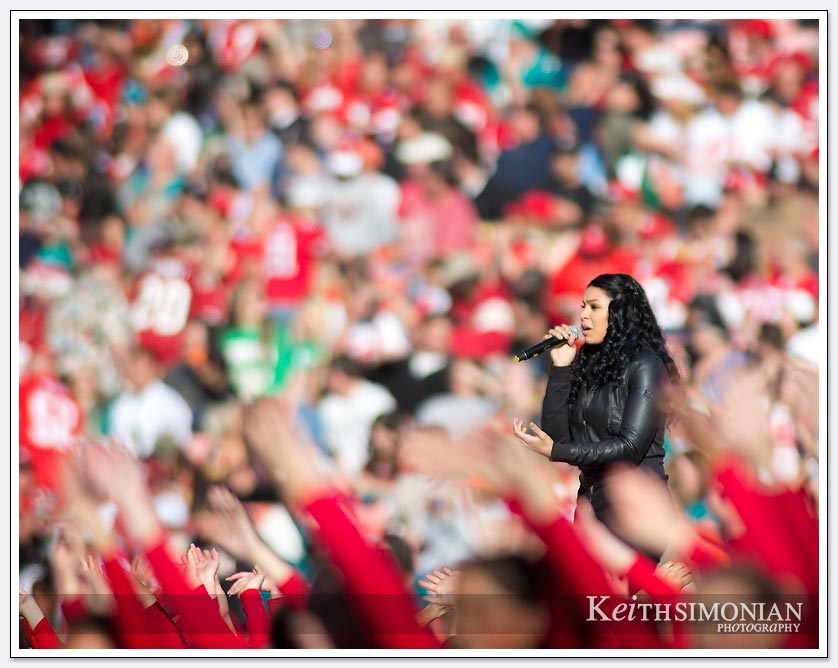 American Idol winner Jordin Sparks is surrounded by a sea of red and gold at 49ers vs Miami halftime show