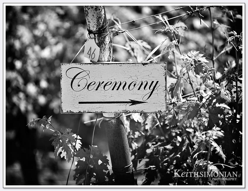 Black and white photo of sign telling guests where the wedding ceremony is at the BR Cohn winery