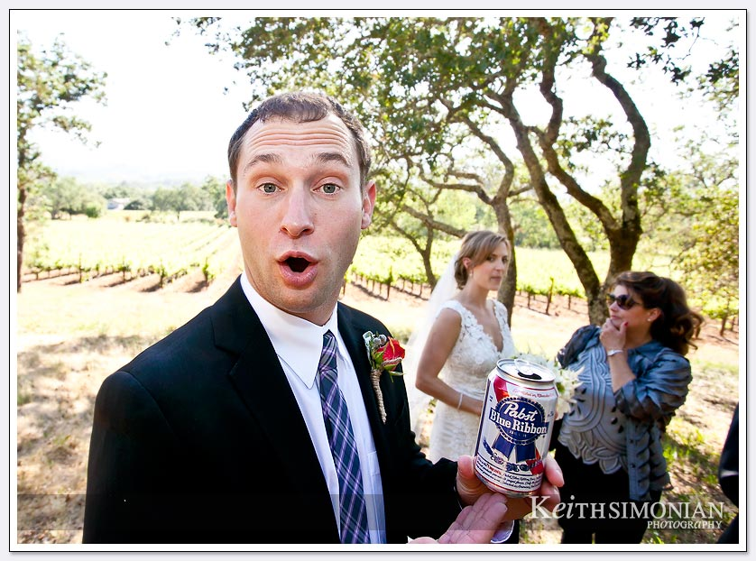 Groomsman holding can of Pabst Blue Ribbon beer at BR Cohn Winery in the Sonoma Valley