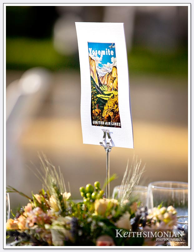 Guests at the wedding reception of place cards of famous California landmarks